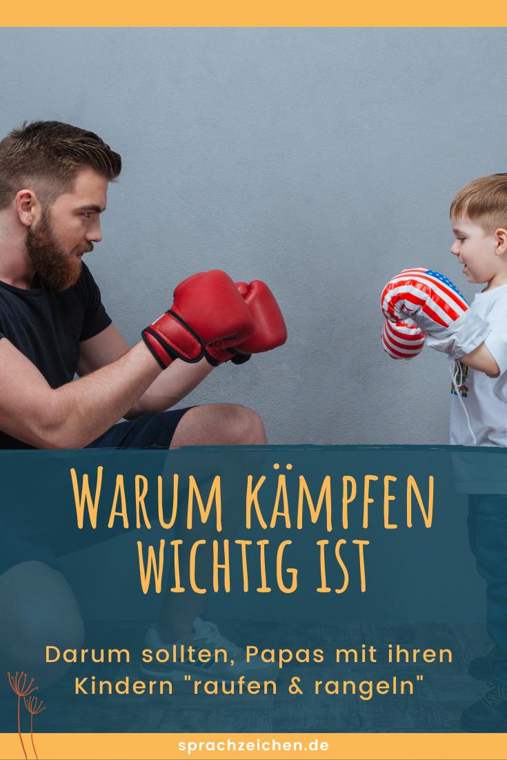 Papa und Sohn mit Boxhandschuhen